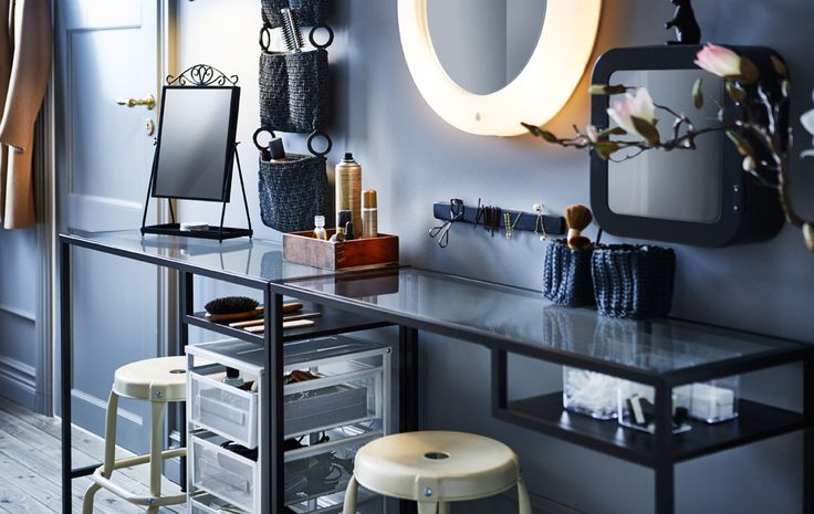 With the help of a narrow table, two stools, some organizers, utility cart and a lighted mirror you can make a hair and makeup station.