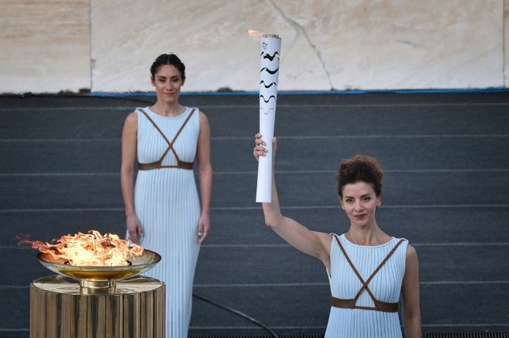 """Brazil takes Rio flame on 100-day countdown Athens (AFP) – Greece on Wednesday handed the Olympic flame over to Rio Games officials setting off the 100-day countdown to the August 5 opening ceremony. """"Brazil is waiting for the flame with excitement and passion,"""" said Rio 2016 organising committee chairman Carlos Nuzman, adding that the Games  https://sports.desiforce.com/brazil-takes-rio-flame-on-100-day-countdown/"""