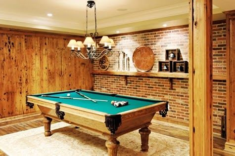 Basement Home Billiard Room Design with Natural Teak Wood Panel Brick Wall and Modern Pendant Lamp Ideas