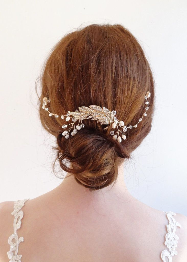 Turn heads with this crystal-and-pearl pick ($85). The centerpiece features an eye-catching leaf-shape ornament while wired pearls and crystals weave out from the sides. // Affordable Bridal Hair Accessories