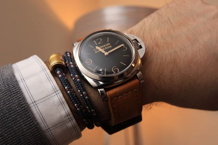 wrist check: show a little of the shirt cuff to contrast, bracelets, and watch