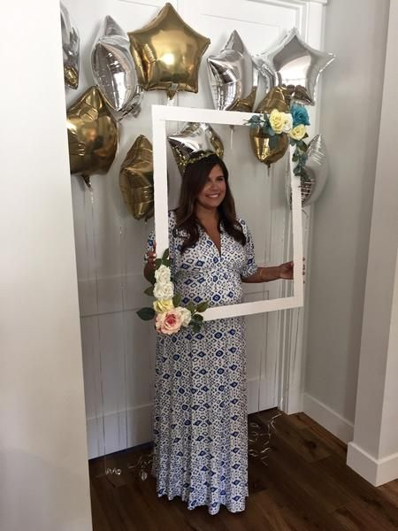 Twinkle Twinkle Little Star Baby Shower. The prettiest mommy to be! Star balloon photo backdrop, and DIY floral frame for photobooth.