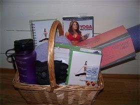 "Yoga Lover's Gift Basket : Everything she needs.  Yoga mat, yoga socks, dvd, drink container, lemonade, towel and yoga journal, note cards and planner.  13""Wx61/2""H  w/o handle.  65.00"