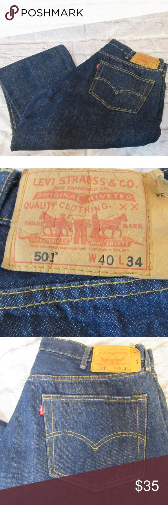"""Levi's 501 W40 L34 Button Fly Jeans M57 EUC Please double-check measurements below for a proper fit.    THE FIT Size - W40 L34 WAIST - Laying Flat - About - 18.50"""" INSEAM - Laying Flat - About - 32.50"""" RISE - Laying Flat - About - 13"""" HIPS - Laying Flat - About - 22"""" LEG OPENING - Laying Flat - About - 9""""  THE DETAILS 5 Pocket Button Fly Medium Wash 100% Cotton    PLEASE FOLLOW MY CLOSET FOR GREAT NEW DEALS EVERYDAY! THANK YOU FOR YOUR BUSINESS! Levi's Jeans Straight"""