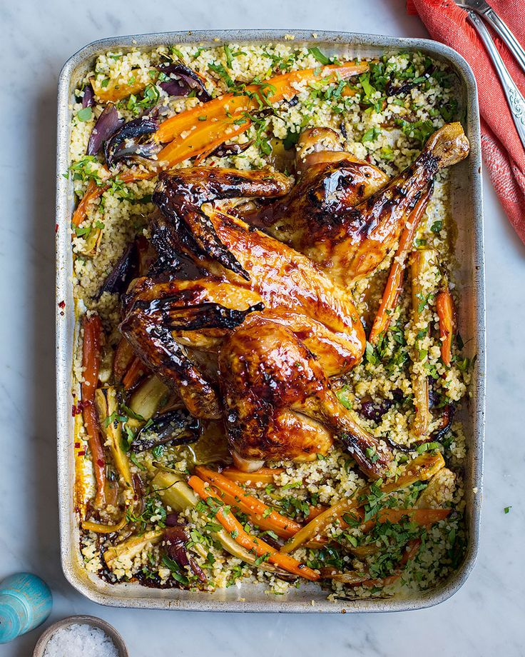 Spatchcocked pomegranate chicken - A glistening, ruby-red roast chicken recipe with roasted winter veg from Donal Skehan's new book 'Fresh'.