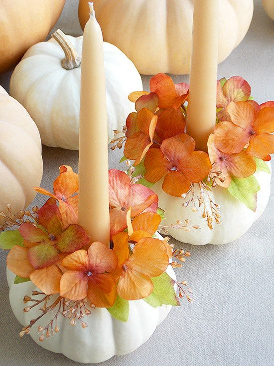 These picture-perfect tapered candleholders set the scene for one beautiful table spread. Want to make sure your candleholders last beyond November? Hot-glue silk flowers to faux pumpkins instead of opting for the real deal, and you'll be enjoying this DIY centerpiece project for years to come. (image credit: Maria Sabella)/