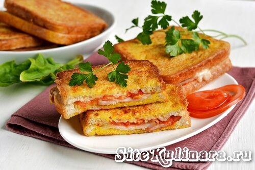 Вкусные и быстрые горячие бутерброды с сыром и ветчиной на сковороде - рецепт с фото