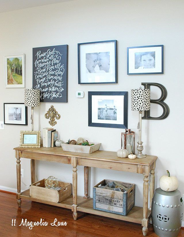 You can easily create a gallery wall of family photos, art and decorative items on any blank wall. A narrow console table is perfect even if the wall is in a a hallway and provides a fun place to display decorative accessories and bring seasonal touches into your home. Finally, just add some buffet lights to brighten up the space for a polished look. Sponsored Pin.
