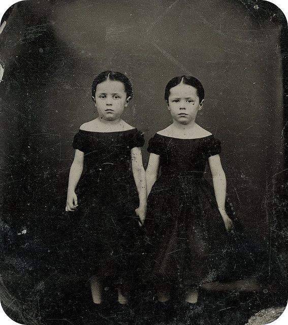 Little girls always creep me out. Especially twins, in a black and white photo. I wonder why they never smiled in those days?