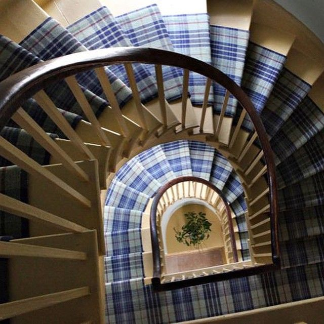 A striking combination of our Ballone wool tweed carpet and Harvest Yellow paint on this elegant spiral staircase. #ANTAInteriors #interiordesign