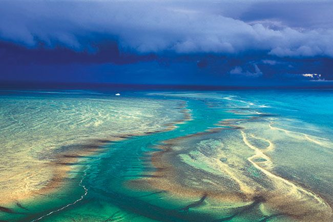 Montgomery Reef, WA.  This wet season photograph of the Kimberley coast captures an approaching tempest over the stunning Montgomery Reef. Picture: Ken Duncan.