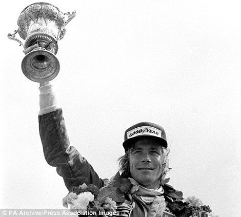 Britain's James Hunt with the winners trophy after winning the John Player British grand Prix at Silverstone in his McLaren