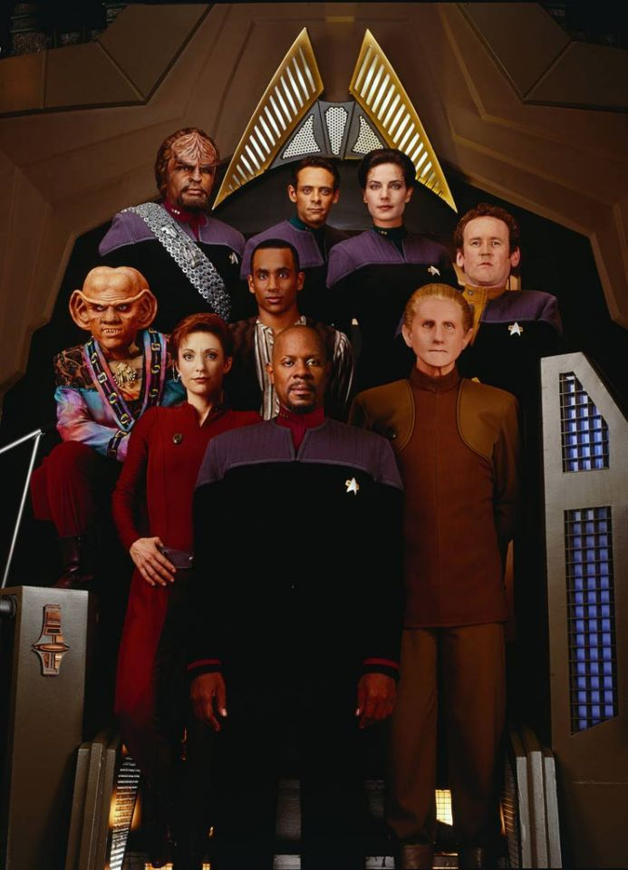 """Set during the same time frame as Next Generation, """"Star Trek: Deep Space Nine"""" (1993-1999) centers the action on board a bustling space station, home to a colorful cast of aliens and humans alike on the outskirts of the galaxy.  Led by Avery Brooks as Commander Benjamin Sisko, the show became known and praised by fans for its dark themes and complex, serialized storyline."""