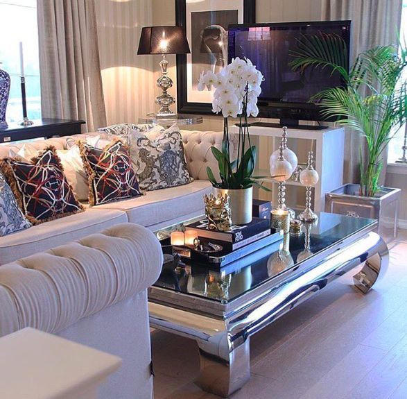 Classy home decor. Mirrored coffee table ideas. Coffee table styling. Fancy home decor. Chic home decor. White flower arrangement inspiration. Living room styling. Skulls