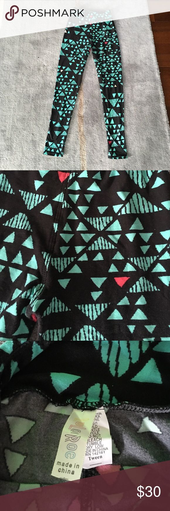 LulaRoe Tween leggings LulaRoe Tween leggings. black, teal, and a touch of magenta. Worn once. Excellent condition. Older pattern - Haven't seen it since purchased. LuLaRoe Pants Leggings