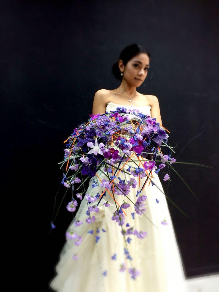 Gorgeous contemporary trailing purple wedding bouquet by Tomas de Bruyne http://www.tomasdebruyne.com/