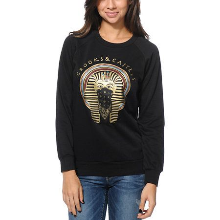 """Reign over the style game in the Crooks and Castles Pharaoh crew neck sweatshirt for girls. Designed with a crew neck collar and long raglan sleeves, this Black pullover sweatshirt has a Pharaoh graphic at the front with Gold """"Crooks & Castles"""" script printed above for a regal look."""