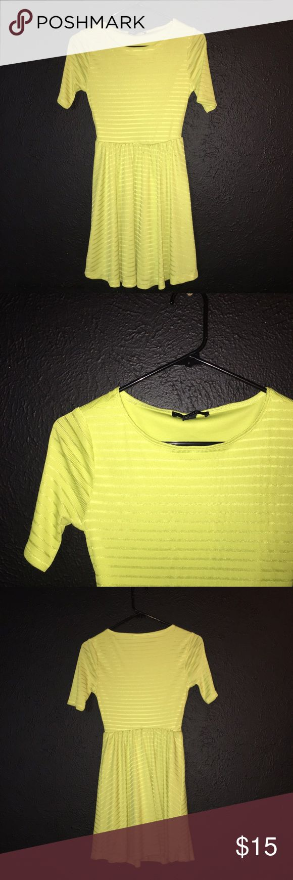 Neon Yellow Dress Neon yellow dress with cool stripey design (I don't know how to describe it haha). But it's 3% spandex so it's got a little bit of that stretchy feel to it. Really cute for spring/summertime. Worn once. Forever 21 Dresses Mini