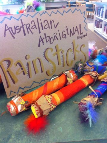 Australian Aboriginal Rain Sticks decorated with craft feathers