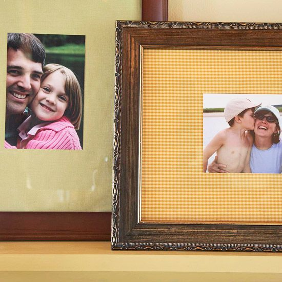 Fabric over white matte in frames. Love this to brighten a wall of photos.