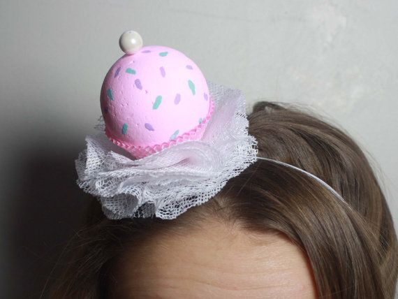This headband is perfect for your little ones birthday!! or their friends.. or just any day really :P A pink cupcake with pastel sprinkles nestles in