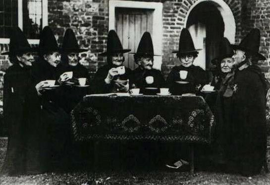 Witches Tea Party? Just a group of Welsh women, wearing traditional folk garb, having tea together.
