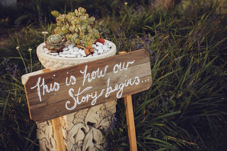 """Our custom timber sign for Shaun and Theresa greeted guests at The Dunes, Palm Beach. """"This is how our story begins"""". Photo by David Campbell Imagery"""