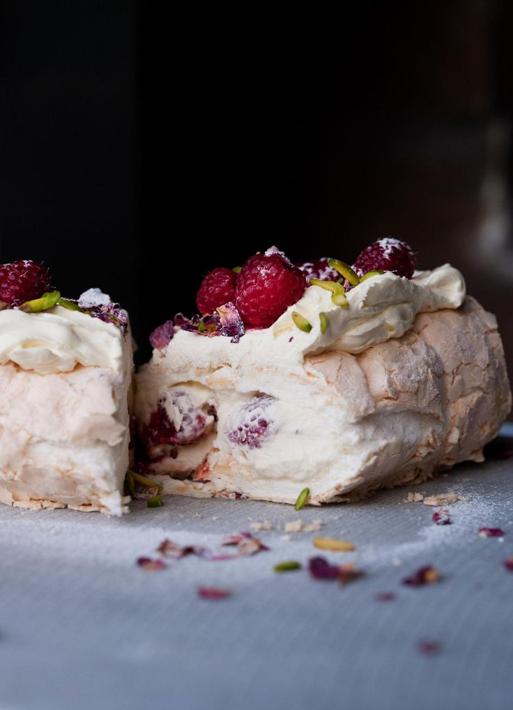 Need we say more? Meringue roulade with fresh raspberries, rose petals and pistachios. Drool.