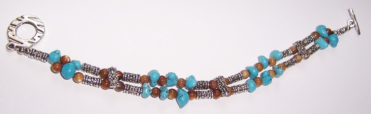 Tiber eye rounds, turquoise chips with silver spacers make up this bracelet. $25