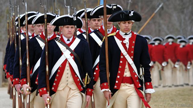 Men dressed as Continental Army soldiers march to demonstrate a fight during revolutionary war as they celebrate George Washingtons birthday at Mount Vernon, Virginia, on February 21, 2011.