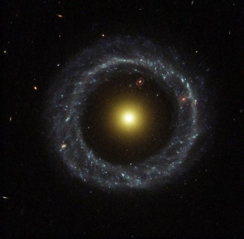 Hoags Object - a ring galaxy discovered in 1950 by astronomer Art Hoag, who initially thought it to be a planetary nebula. A nearly perfect ring of hot, blue stars pinwheels about the yellow nucleus of this unusual galaxy