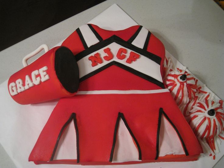 7th birthday cake includes cheerleading outfit, megaphone and pom poms.  Outfit is devils food cake with chocolate filling and chocolate buttercream frosting under marshmallow fondant.  Megaphone and pom poms are rice krispies treats.  Thanks for looking!