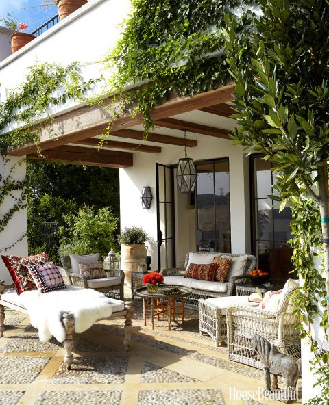 The terrace is outfitted with Kingsley-Bate's Southampton seating, with cushions in a Perennials fabric.
