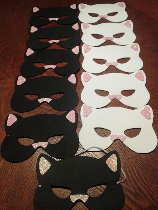 Kitty Cat Masks. Perfect for Kitty Cat themed birthday party! The one on the bottom was purchased at Michael's for $1. All others were made using black, white, & pink foam, glitter (for the nose and ears), and 1/8th inch elastic. The store-bought mask was used as the stencil.