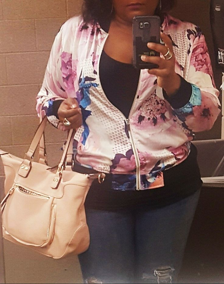Bomber jacket and purse styled by Stitch Fix...perfect fit and style for me! I added a low cut black tank and light blue ripped jeans for the finish.