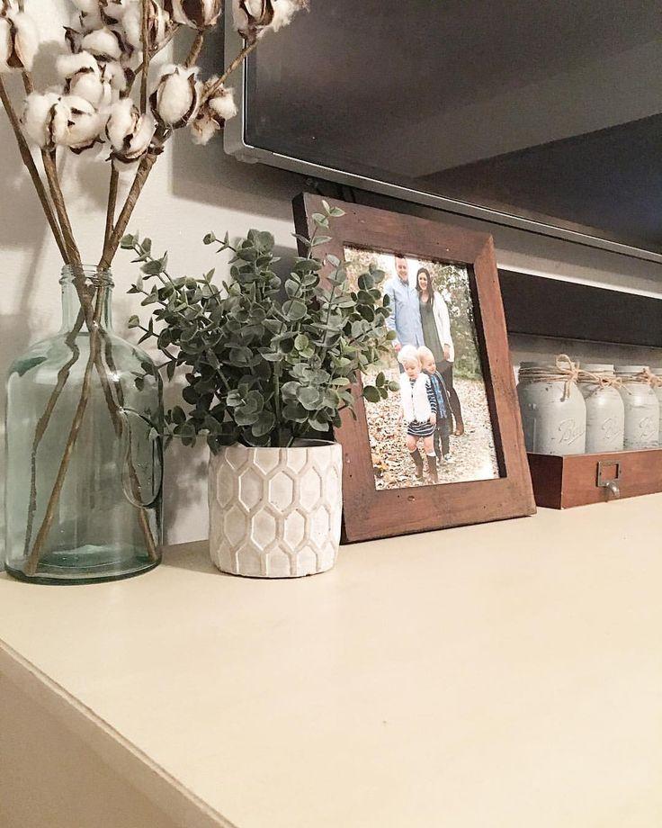 Living Room Decor, tv console decor, tv console, tv, white tv console, media console, faux greenery, cotton stems, mason jars, family photo, tv  Instagram- @rocknrob