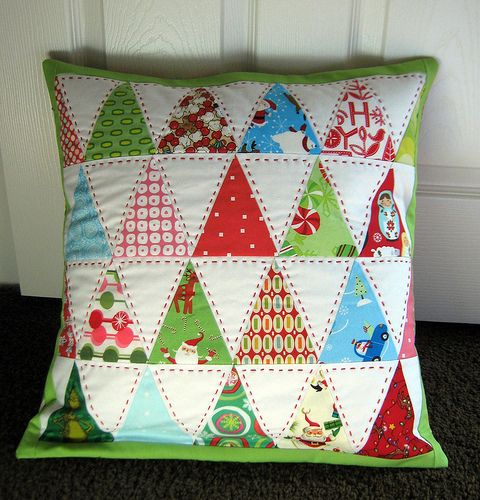 Triangle Christmas pillow.  Love the red stitching. ❤️