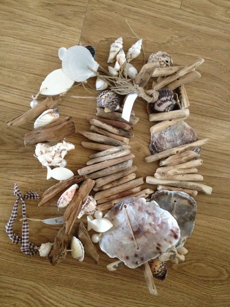 Decoratie drijfhout en schelpen