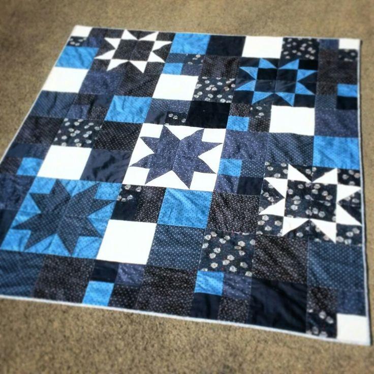 Blue white star night quilt.