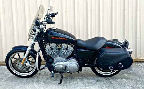 Used 2013 Harley Sportster 883 Motorcycles For Sale in Alabama,AL. 2013 Harley Sportster 883, This 2013 Harley Davidson 883 is under 1k miles!! Comes with additions such as: Saddle bags, Windshield, Vance & Hines Exhaust and GPS. This is such a great deal - stop by and check it out today! Located at Hall's Motorsports Eastern Shore.