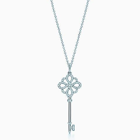 Tiffany Keys knot key pendant in 18k white gold with diamonds on a chain.