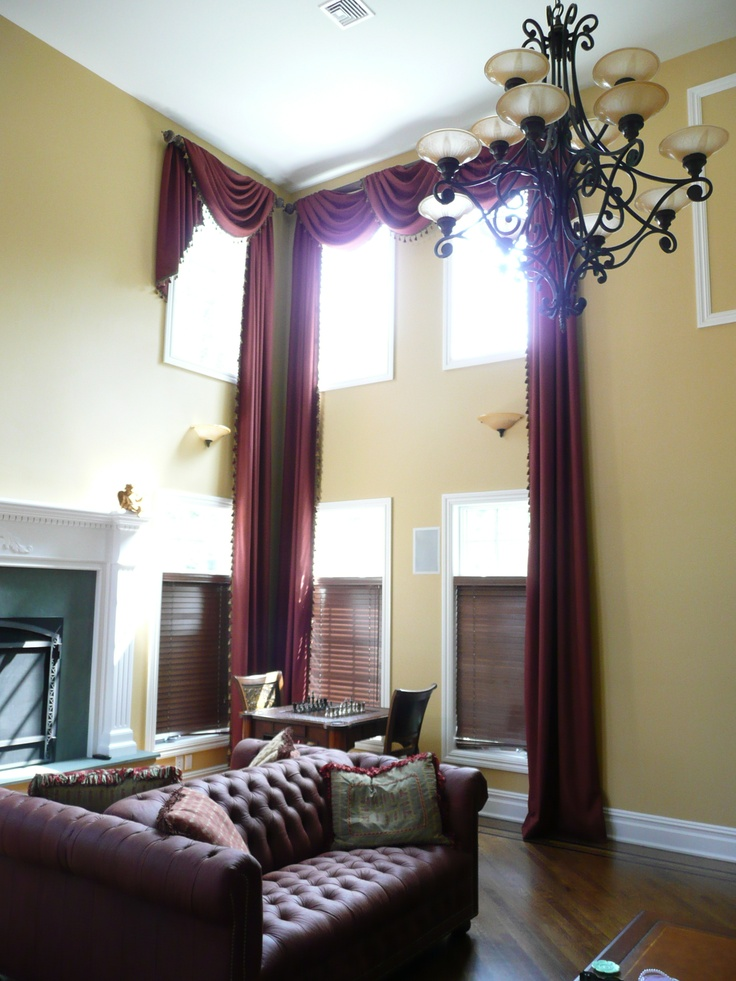 Super high ceilings and super long drapes not sure how High ceiling curtain ideas