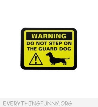 funny billboard sign please do not step on guard dog