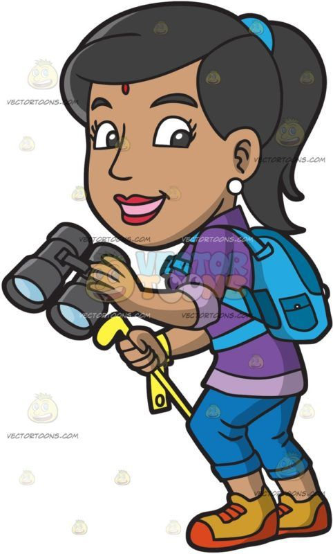 An Indian Woman Going On A Trek :  An Indian woman with light brown skin red mark on her forehead wearing a purple shirt blue pants gold with red rubber shoes blue backpack white pearl earrings smiles while holding a gray binoculars in her left hand and a yellow trekking pole with strap in her right hand