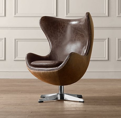With a nod toward Danish modern design of the 50s, this fresh and fun reproduction offers a comforting cocoon that's perfect for reading and relaxation on a smaller-sized scale.