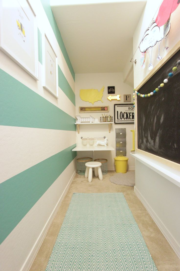 Turquoise and Yellow Playroom (transformed from a narrow closet) into a useful space for kid's work and play!