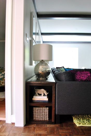 Table/shelf behind couch for books, lamp, etc. I like this one better than some of the skinny planks I have seen.