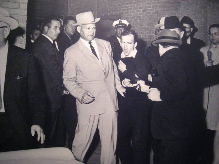 Nightclub owner Jack Ruby shoots Lee Harvey Oswald, the man who assassinated JFK, on November 22, 1963.