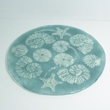 Handpainted images are fused between two layes of glass to create a unique cheeseboard. Made locally and only found at the WOW Gallery Dorking - its a great price at £85