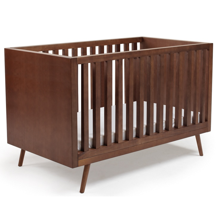 Inspired by the clean lines and streamlined shapes of mid-century design, the Ubabub Nifty Timber Crib brings the 1950s aesthetic to the nursery, together with contemporary design features. It's easy to assemble, clean and maintain.
